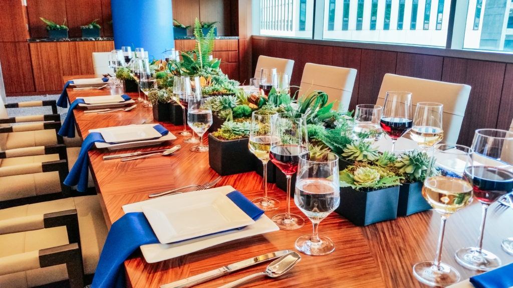Holiday Dinner at Endeavor, table set with decor and wine glasses