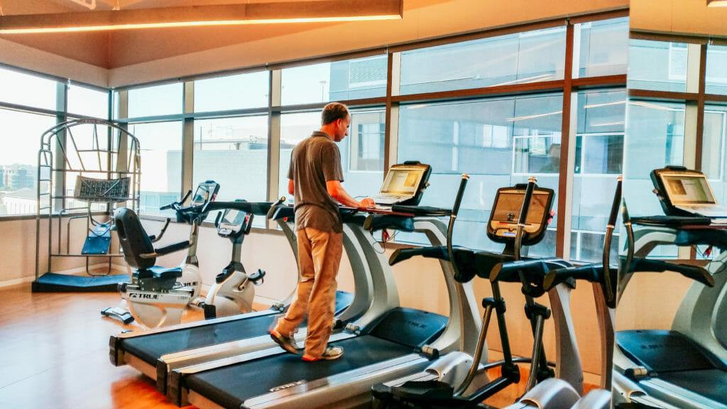 Endeavor Gym, guy on treadmill