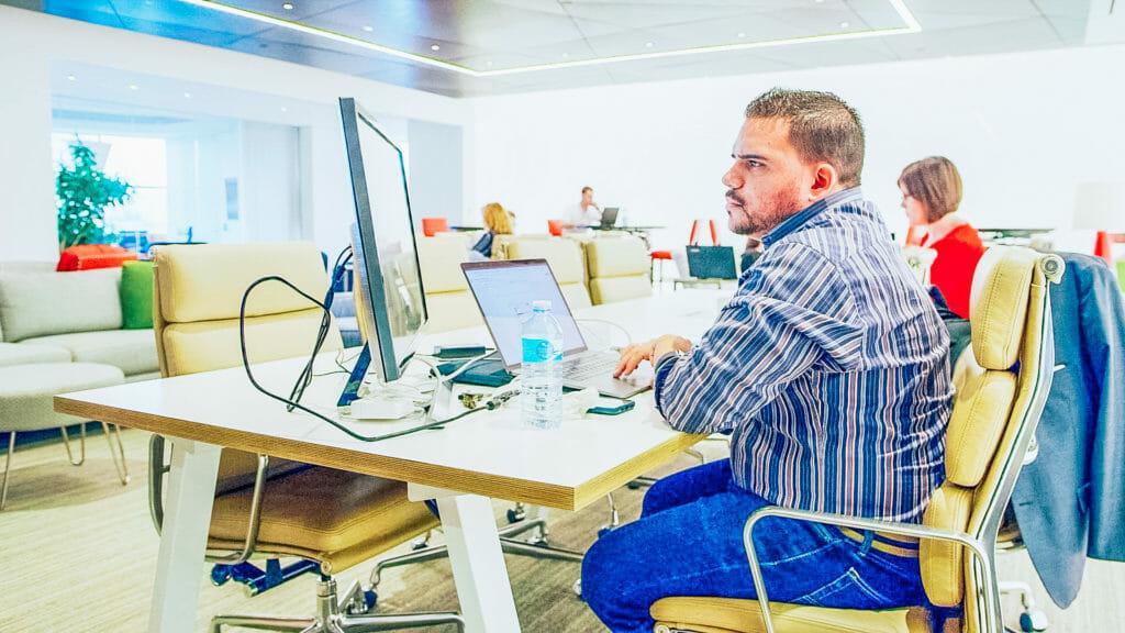Endeavor Member Working at Private Desk