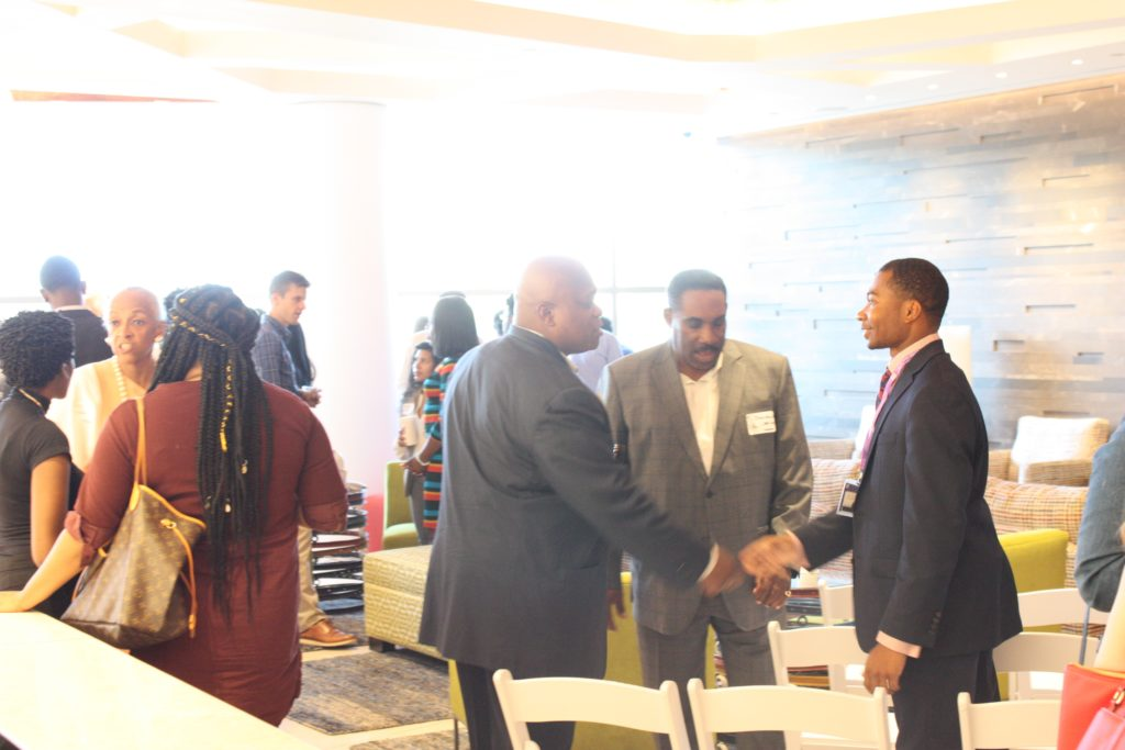 Summer Scholars shaking hands and networking at the summer scholars event
